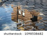 cobblestone with reflection of... | Shutterstock . vector #1098538682