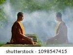buddhist monks meditate to calm ... | Shutterstock . vector #1098547415