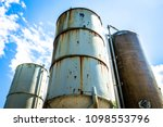 old silo tanks in front of blue ...   Shutterstock . vector #1098553796