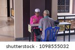 Small photo of Malacca, Malaysia; 25/05/2018; Muslim man paying the zakat as the obligation for every muslim during ramadan at Al Azim Mosque, Malacca, Malaysia.