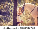 Blond Girl Hug Her White Horse...