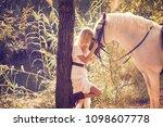 Blond Girl Hug Her White Horse...