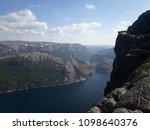 the norwegian fjord lyusebotn ... | Shutterstock . vector #1098640376
