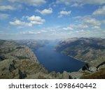 the norwegian fjord lyusebotn ... | Shutterstock . vector #1098640442