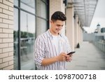 man texting on phone. casual... | Shutterstock . vector #1098700718