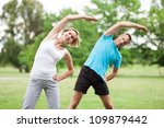 Couple Working Out In Park