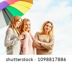 three pretty young women... | Shutterstock . vector #1098817886