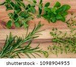 wooden board with fresh herbs | Shutterstock . vector #1098904955