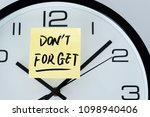 Small photo of Dont forget written on sticker clock.