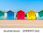 A Row Of Colorful Wooden Beach...