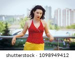woman dressed in a red blouse... | Shutterstock . vector #1098949412