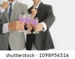 business group cheers  wine... | Shutterstock . vector #1098956516