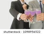 business group cheers  wine... | Shutterstock . vector #1098956522
