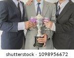 business group cheers  wine... | Shutterstock . vector #1098956672