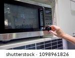 woman's hands adjusting timing... | Shutterstock . vector #1098961826
