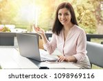 young business woman looking in ... | Shutterstock . vector #1098969116