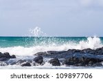 Wave Crashing On The Rocky Reef