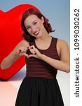 beautiful woman making a heart... | Shutterstock . vector #1099030262