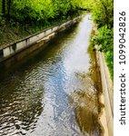 calm river in a ditch or gutter ... | Shutterstock . vector #1099042826