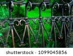 metal fence with forged elements | Shutterstock . vector #1099045856