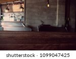 wood table on blur of cafe ... | Shutterstock . vector #1099047425