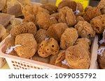 natural sponges in local market.... | Shutterstock . vector #1099055792