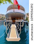 Small photo of SYMI, GREECE - May 15, 2018: Gangway yacht in port of Gialos, Symi island, Greece