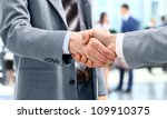 handshake in front of business... | Shutterstock . vector #109910375