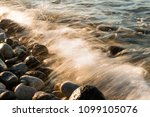 waves hit to the stones on the... | Shutterstock . vector #1099105076
