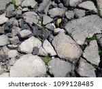 broken asphalt in the street   Shutterstock . vector #1099128485