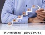 man holding increasing arrow...   Shutterstock . vector #1099159766