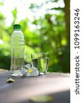 water bottle and glass of water ... | Shutterstock . vector #1099163246
