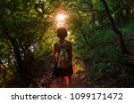 girl hiking alone in sun bright ... | Shutterstock . vector #1099171472