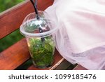 a cup of mojito stands on the... | Shutterstock . vector #1099185476