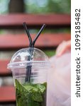 a cup of mojito stands on the... | Shutterstock . vector #1099185482