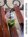 a cup of mojito stands on the... | Shutterstock . vector #1099185536