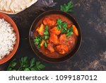 chicken tikka masala with rice. ... | Shutterstock . vector #1099187012