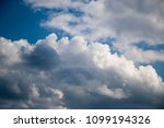 white clouds against the blue...   Shutterstock . vector #1099194326