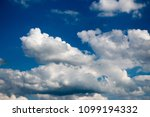 white clouds against the blue...   Shutterstock . vector #1099194332