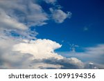 white clouds against the blue...   Shutterstock . vector #1099194356