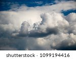 white clouds against the blue...   Shutterstock . vector #1099194416