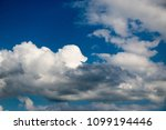 white clouds against the blue...   Shutterstock . vector #1099194446