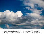 white clouds against the blue...   Shutterstock . vector #1099194452