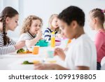 Group Of Children Eating...