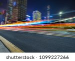 vehicle light trails in city at ... | Shutterstock . vector #1099227266