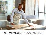 young african american waiter... | Shutterstock . vector #1099242386
