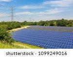 big field with solar collectors ...   Shutterstock . vector #1099249016