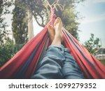 relaxing in the hammock  nude... | Shutterstock . vector #1099279352