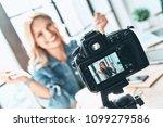 filming. beautiful young woman... | Shutterstock . vector #1099279586