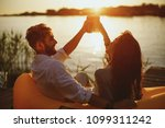 young happy couple enjoy in... | Shutterstock . vector #1099311242
